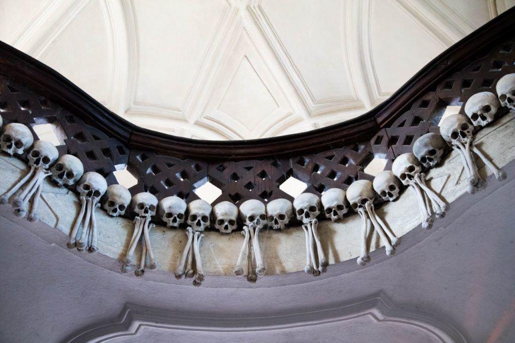 Skulls and bones decorate a balcony at the Sedlec Bone Church.