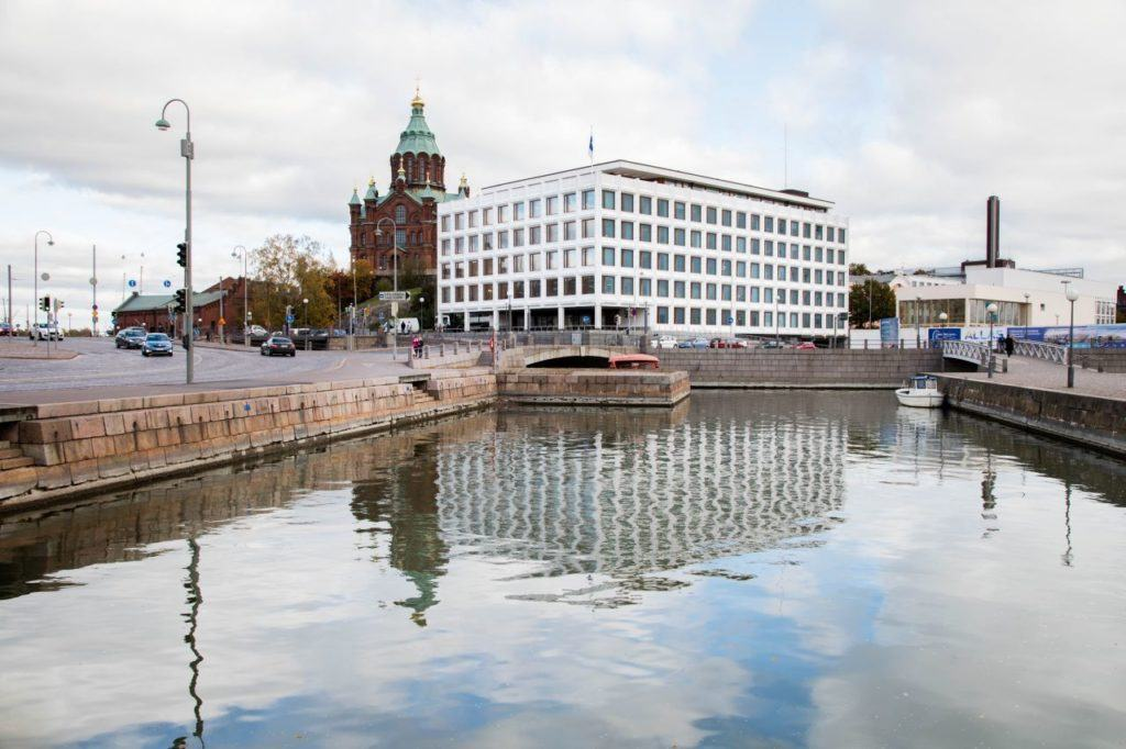 The striking Stora Enso building reflecting off the water in Helsinki harbor.