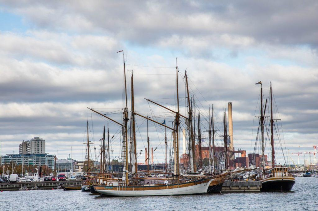 Sailboats and tall ships moored in the harbor in Helsinki, Finland.