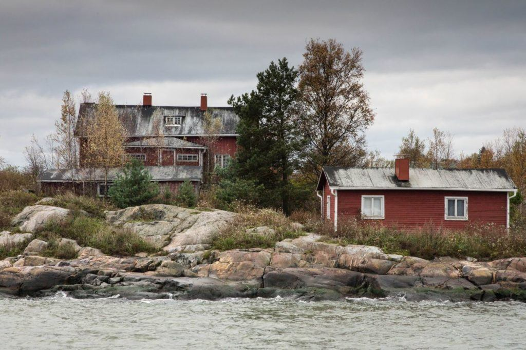 Charming red houses near the water in Finland.