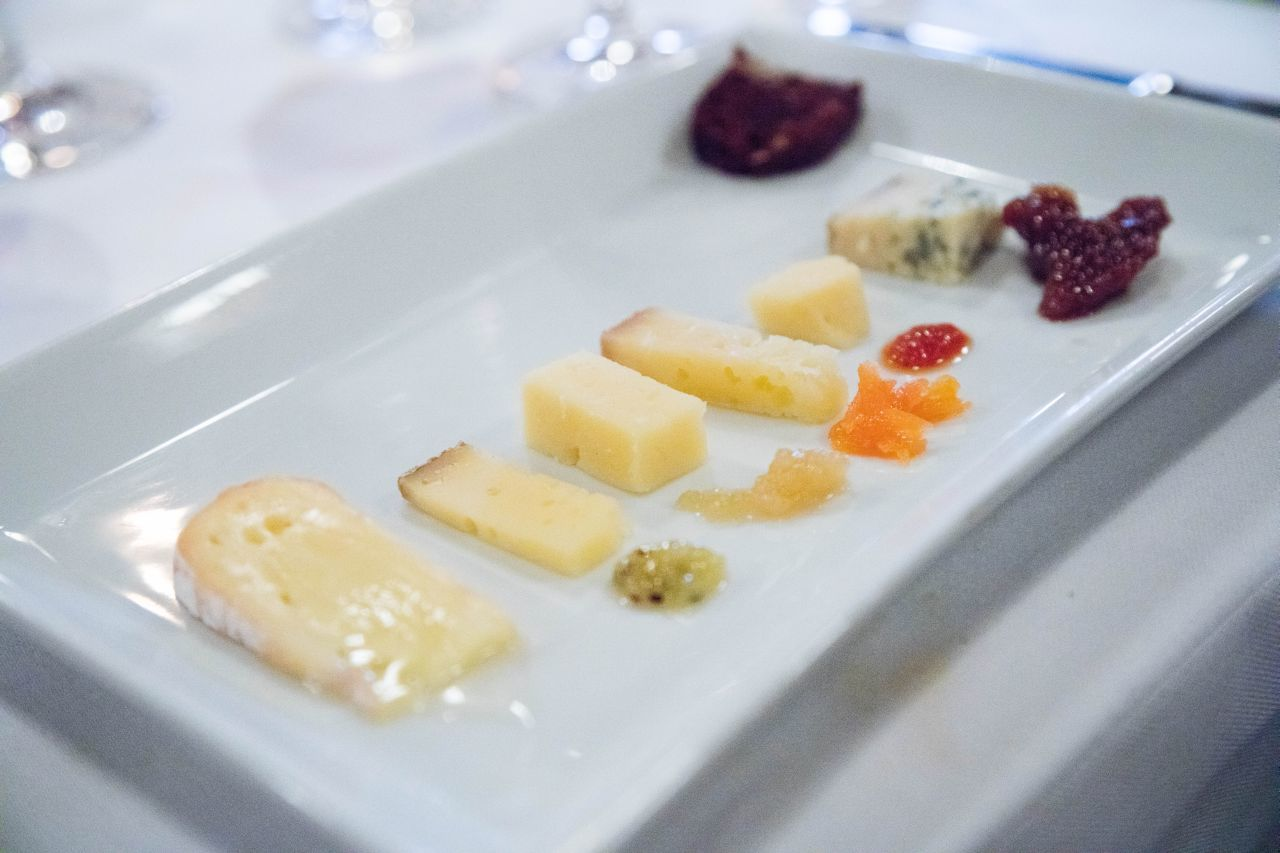 An opulent cheese plate with six different cheeses.