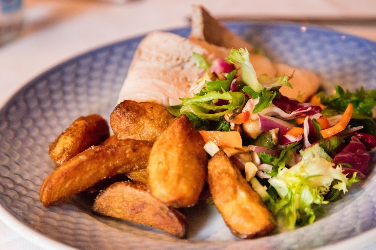 The food in Sweden we ate is hearty, like this plate of fried potatoes, fish, and fresh salad.