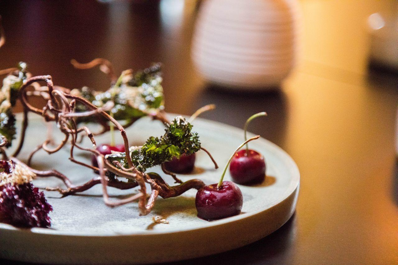 Foie gras stuffed cherries with crispy kale chips.