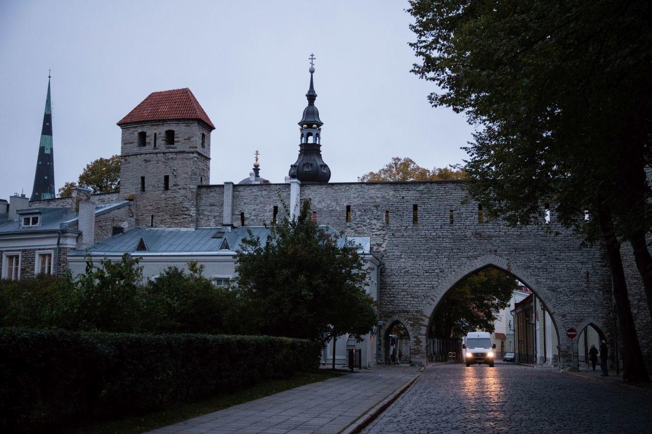 A car driving along the historic streets of Estonia.