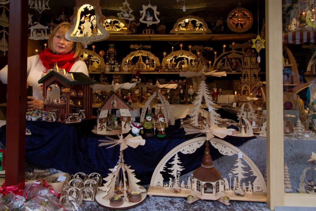 Wooden Nativity and winter scenes at a stall in the Christmas Market.