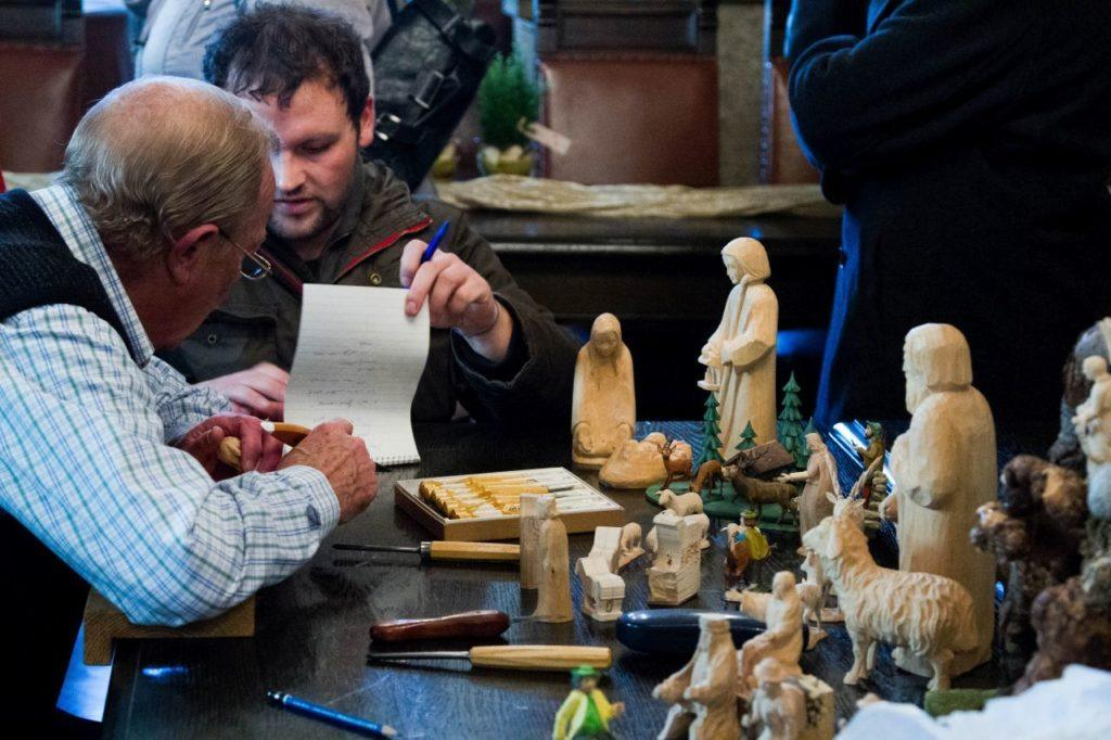 Artist creating wooden sculptures at the Christmas Market.