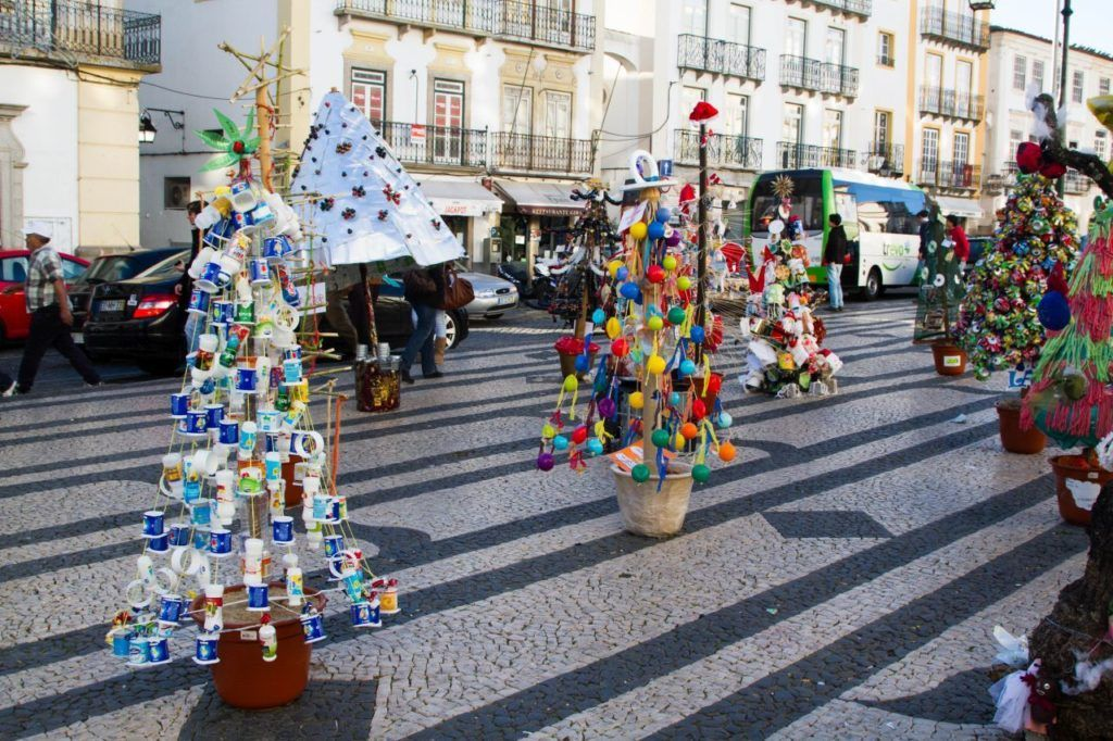 Christmas trees made out of recycled items on display in a Portuguese street.