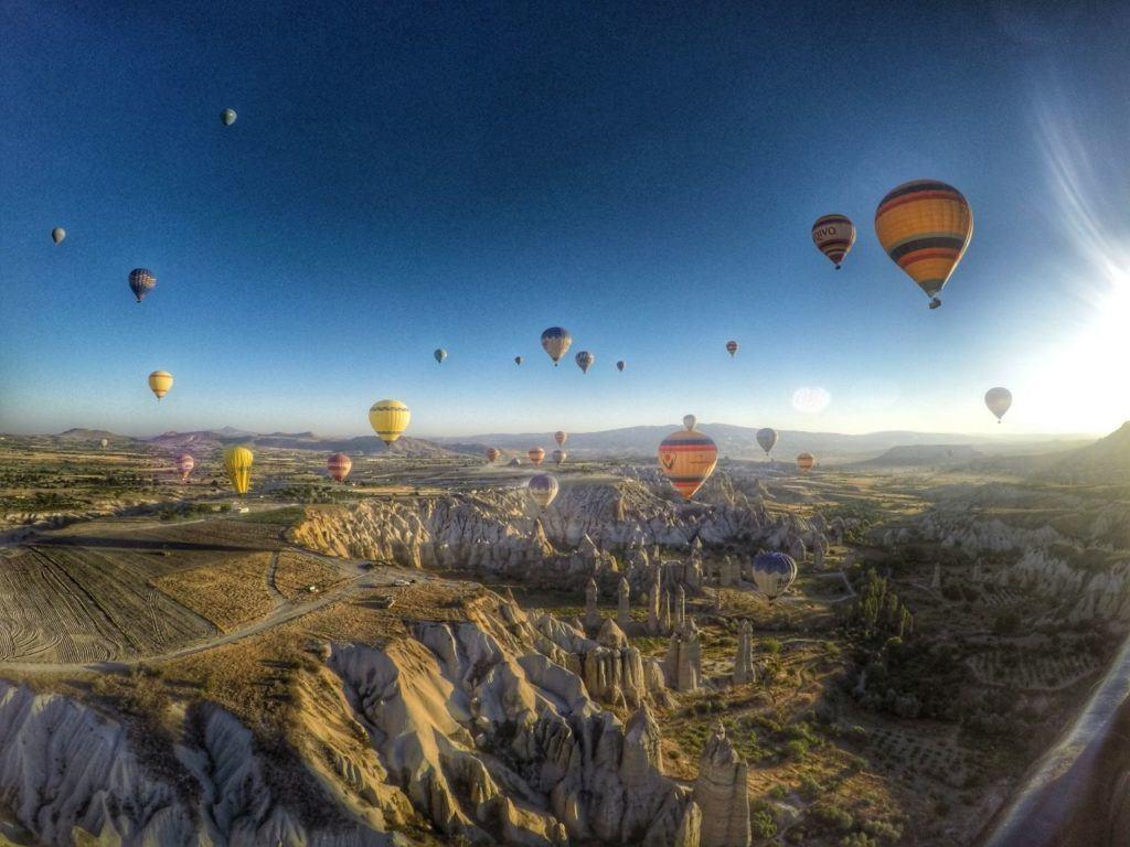 Hot air balloons fly over the fairy chimneys of Cappadocia, Turkey.
