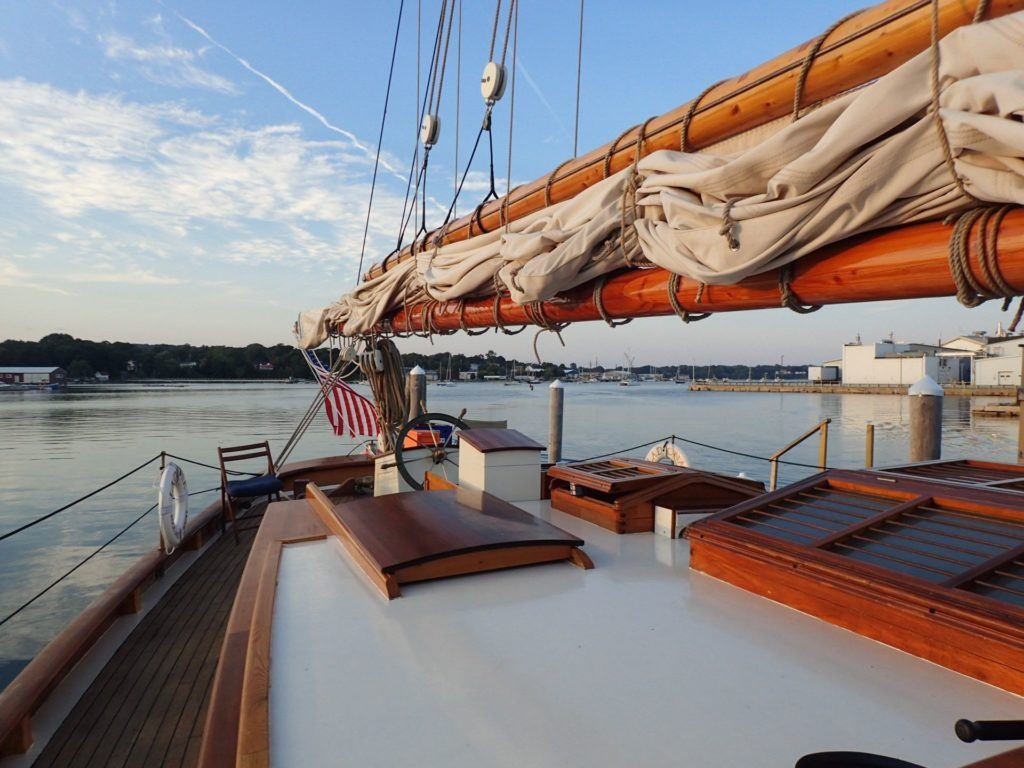 The aft end of a wooden sailing yacht in Maine.