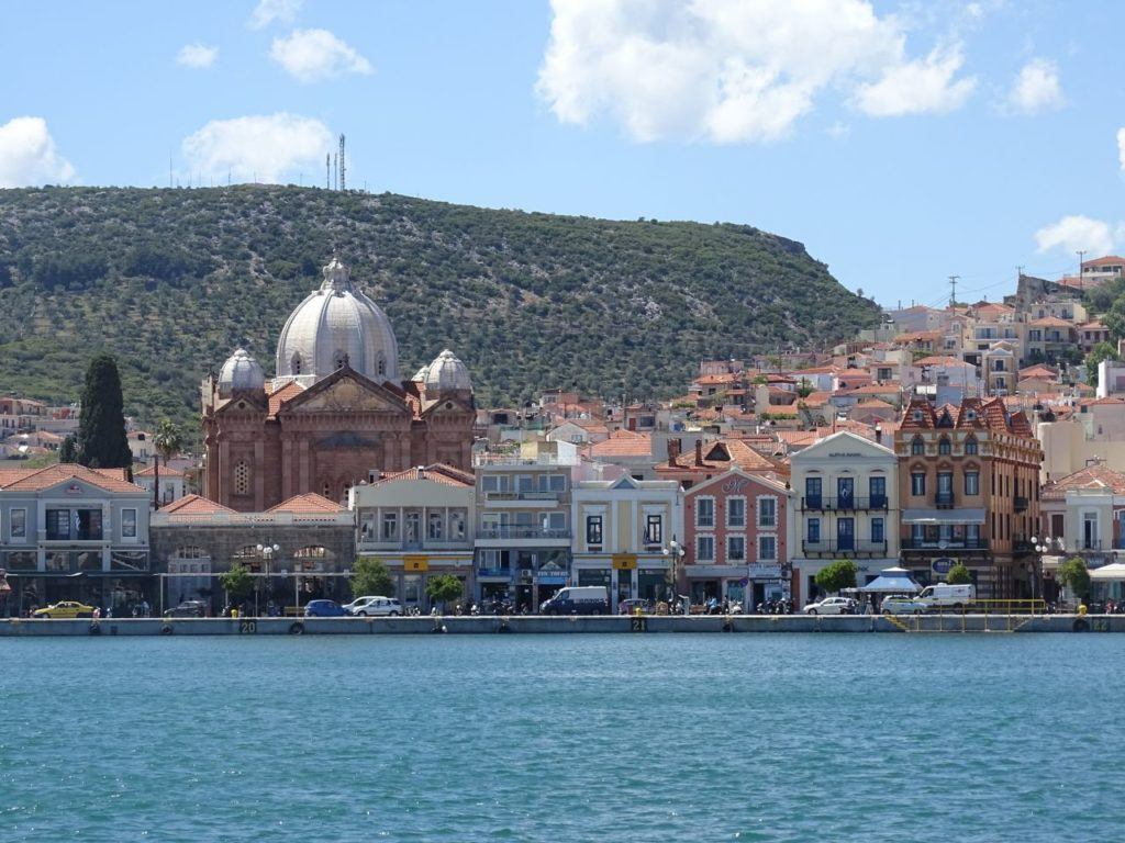 Waterfront buildings seen from the ocean at Lesvos, Greece.