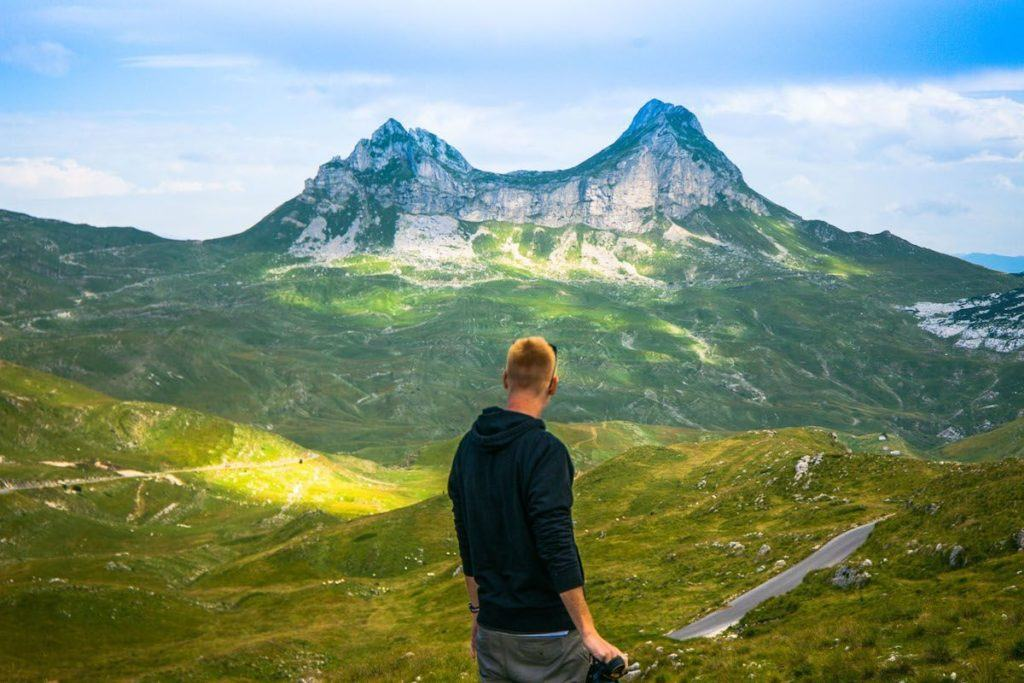 Dave looks out over the lush valley and jagged mountain peaks at Durmitor National Park in Montenegro.