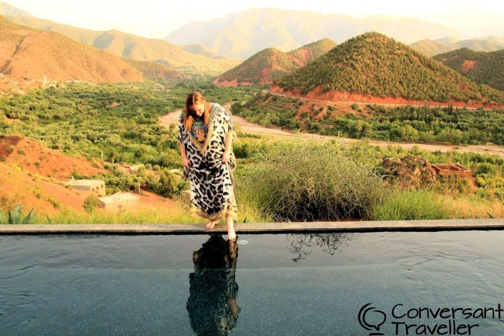 Heather dips a toe into the fabulous infinity pool at the Kasbah Bab Ourika in Morocco.