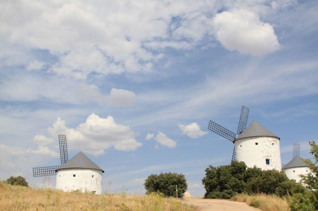 White washed windmills shining in the Spanish sun.