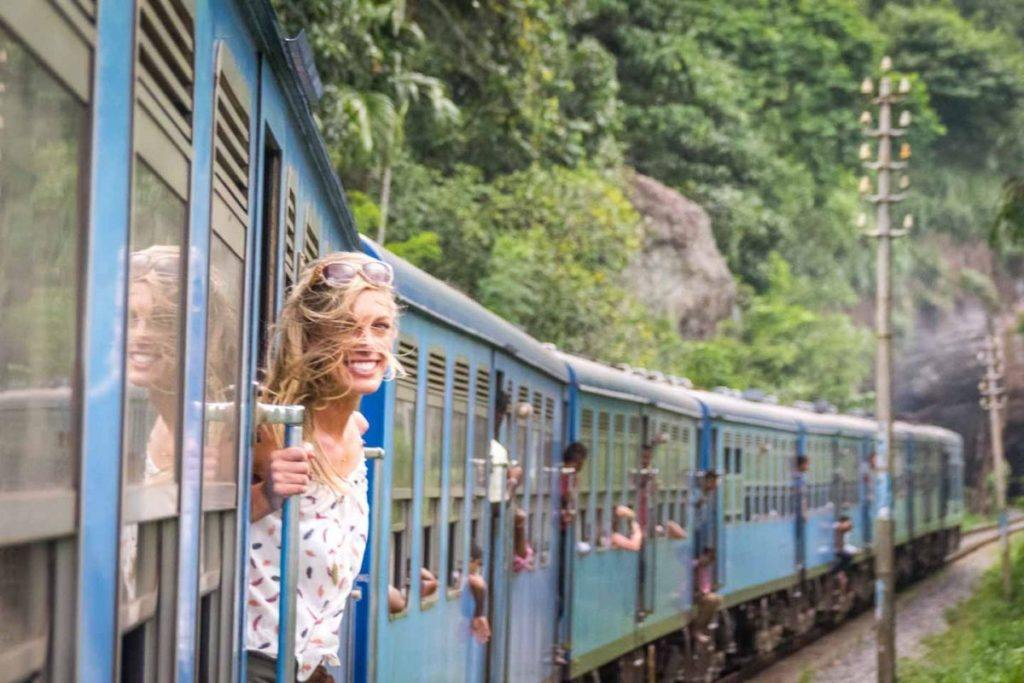 Hannah looks out the open door of the train in Sri Lanka.