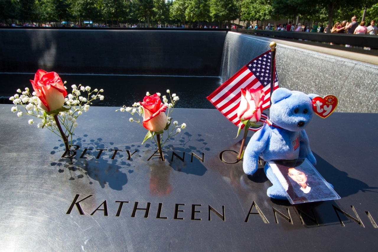 Family members often place mementos on the name plaques at the September 11 Memorial.