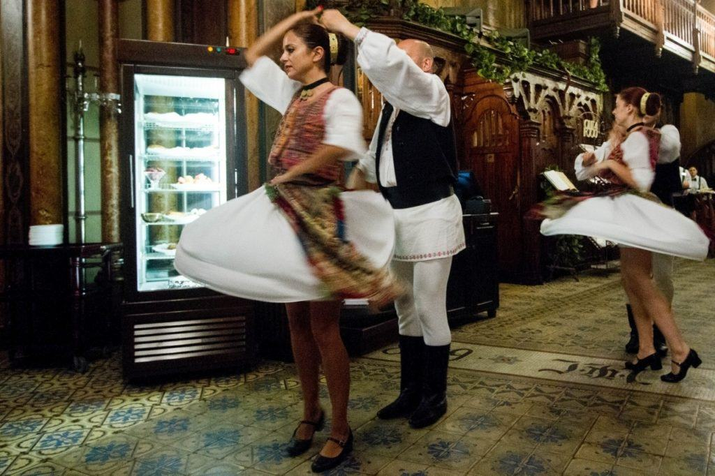 Attending a traditional dinner and show is one of the top things to do in Bucharest.