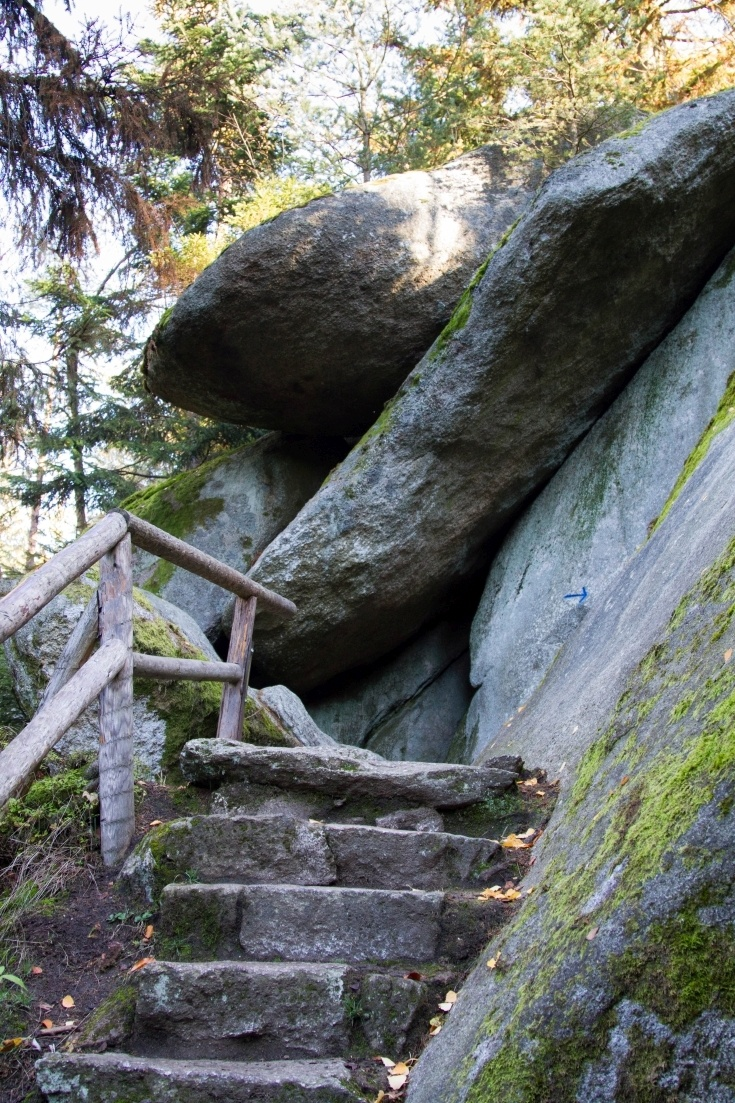 A wooden staircase helps you navigate the huge boulders.