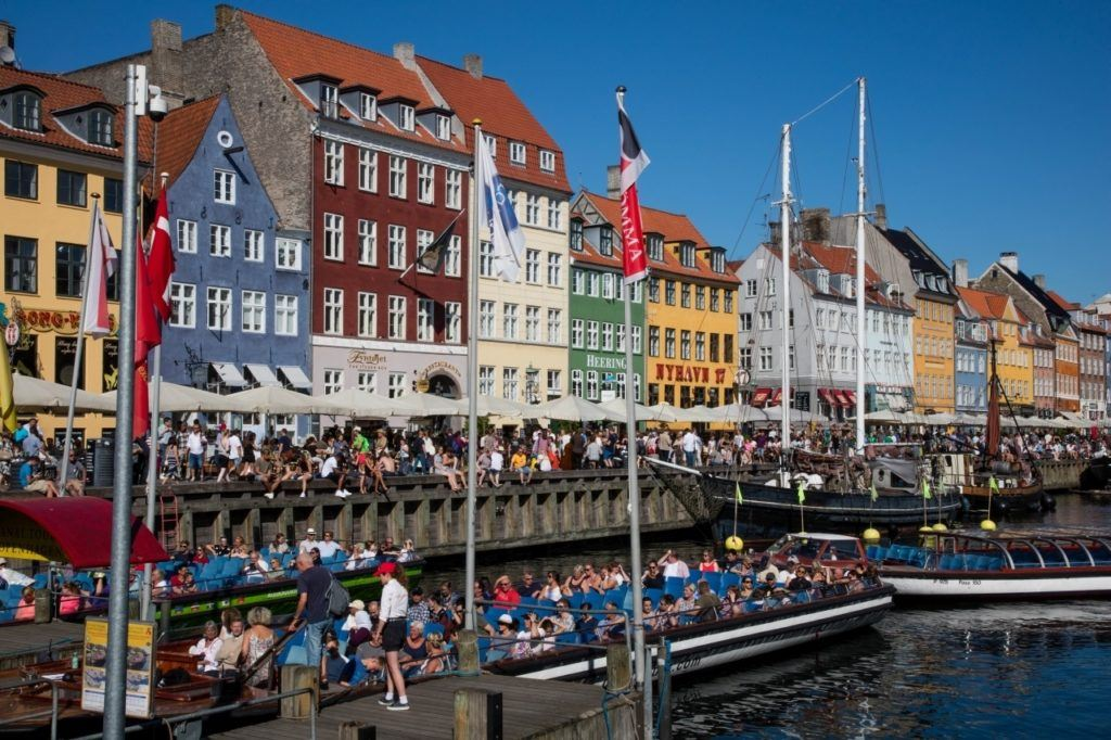 Crowded cruise boats in Nyhaven show just how this is a must do in Copenhagen.