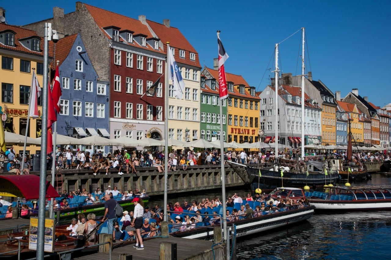 Crowded cruise boats in Nyhaven show just how this is a must do in Copenhagen