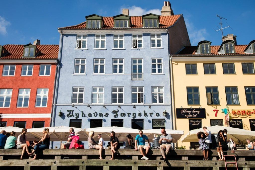 Relax and watch the boats go by, one of the best things to do in Copenhagen on a sunny summer afternoon.