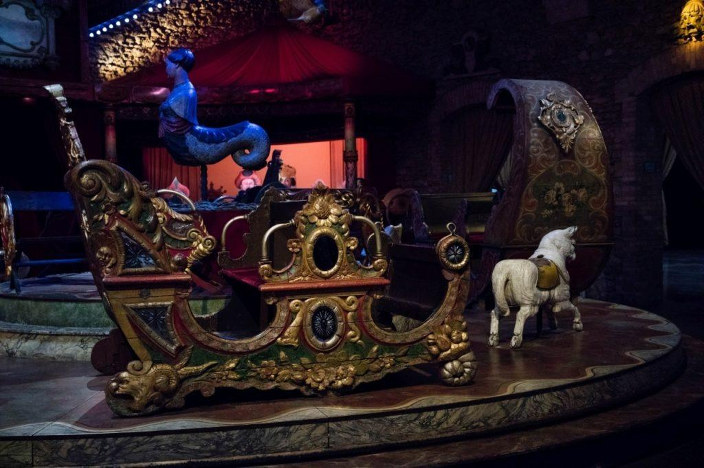 Taking a turn at all the great rides in the carnival arts museum of Paris.