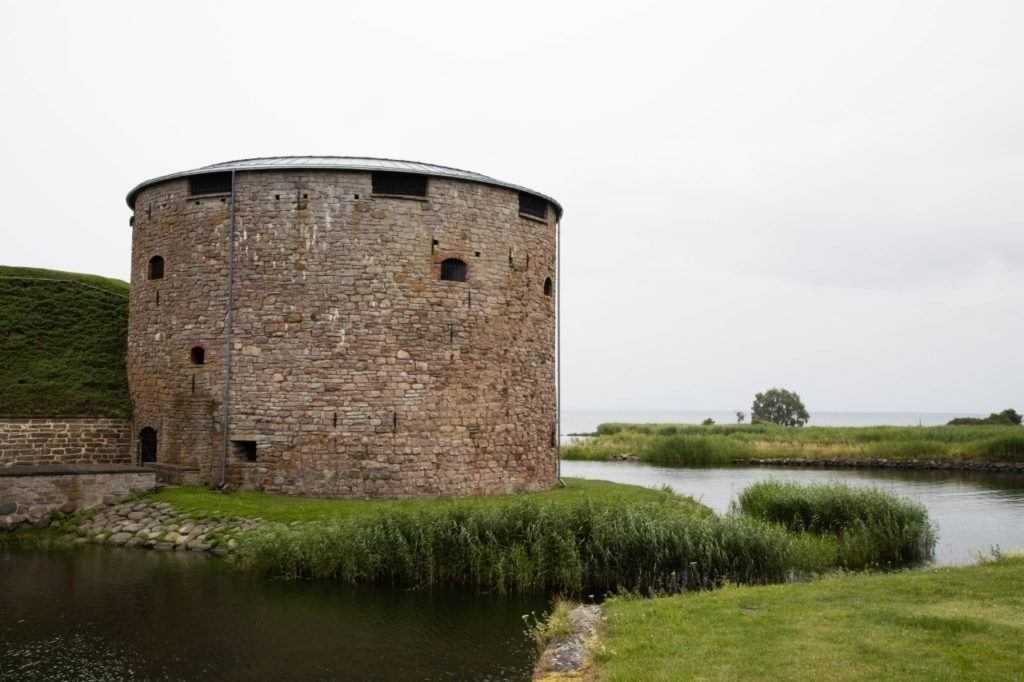 Round wall tower at Kalmar castle and moat.