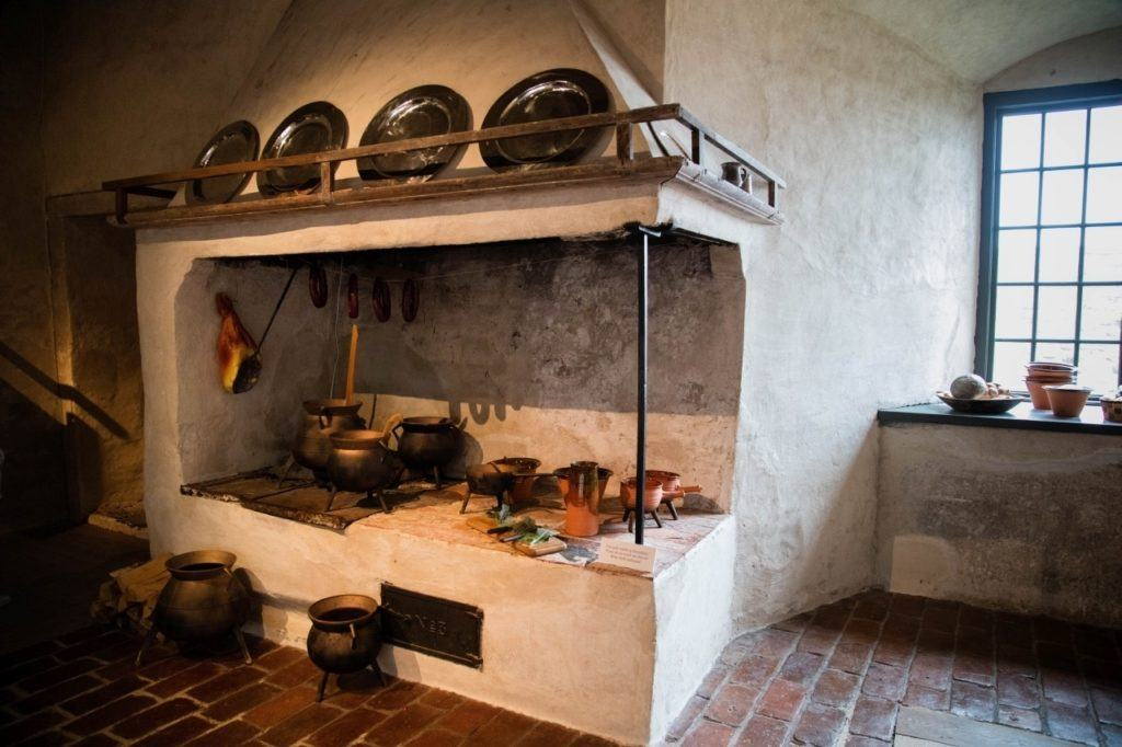 Kalmar castle kitchen with old pots, pans, and stove.