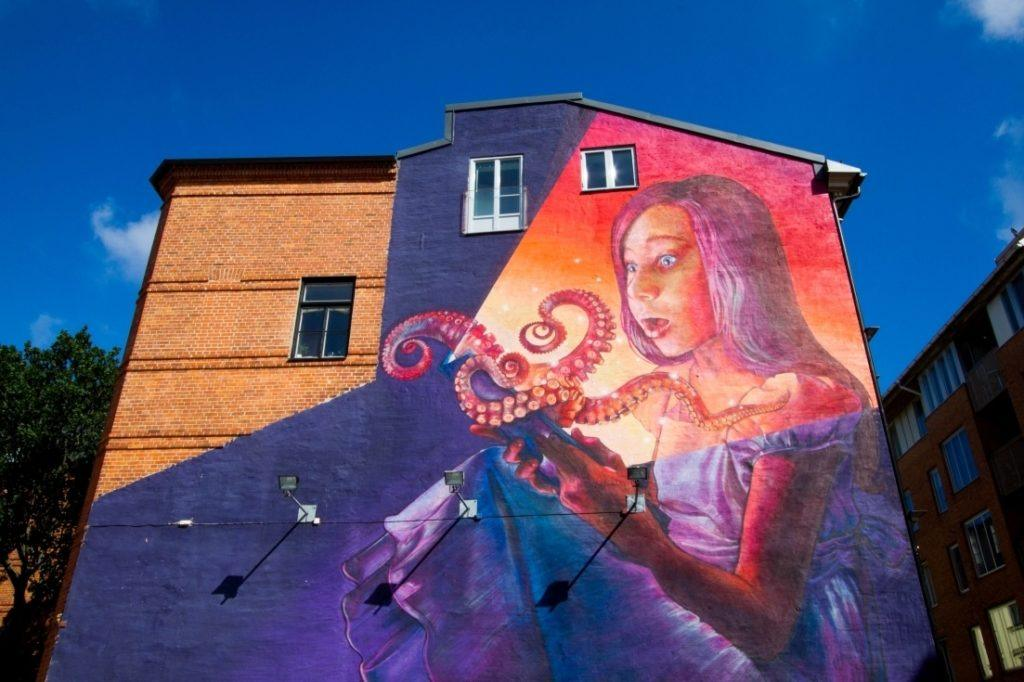 Building mural of girl with octopus in Malmo, Sweden.