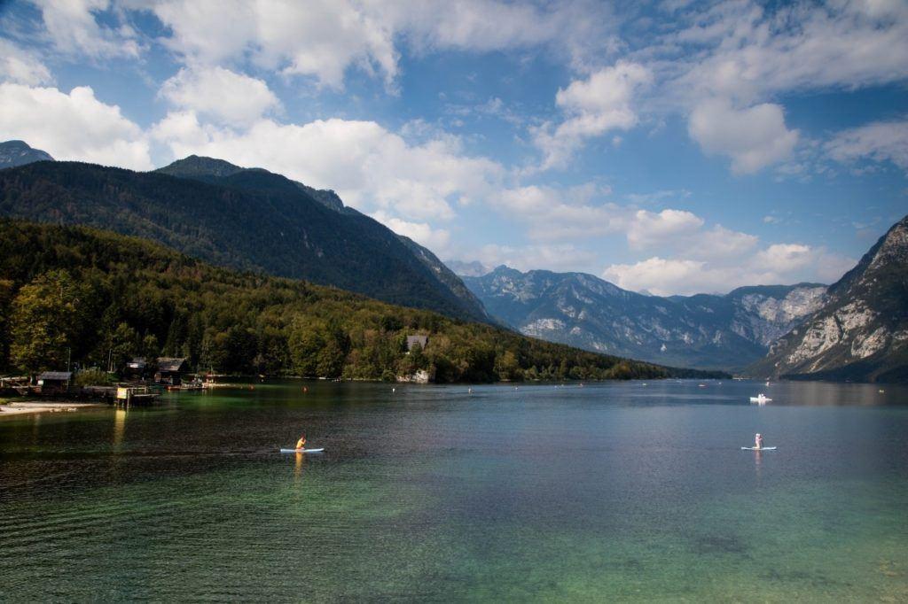 Paddle boarders on Lake Bohinj, Slovenia.