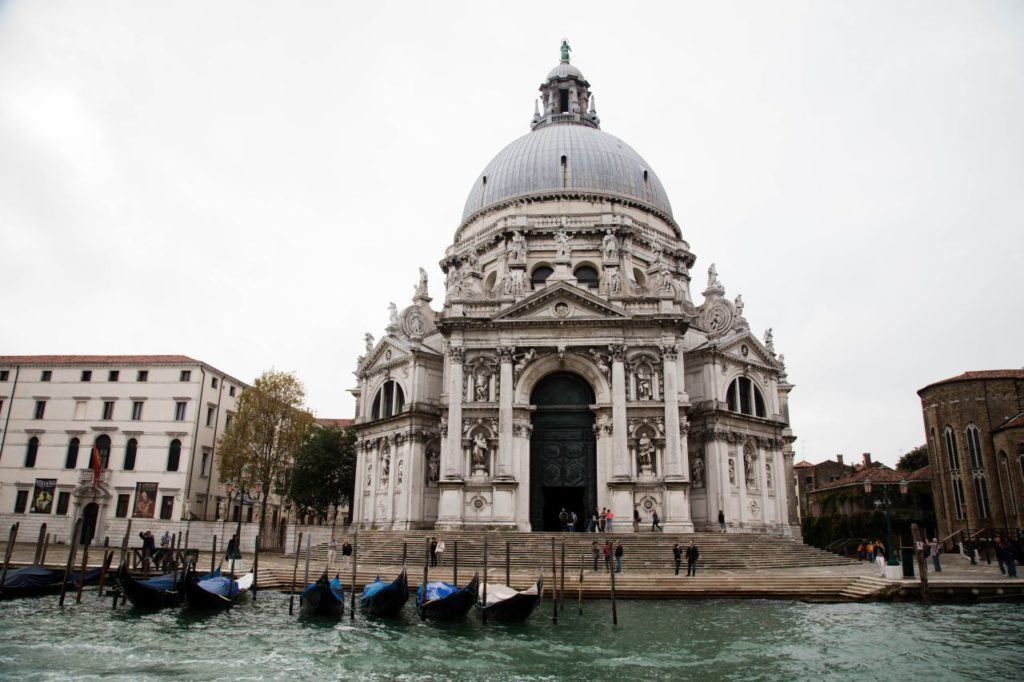 Gondolas moored in front of church in Venice.