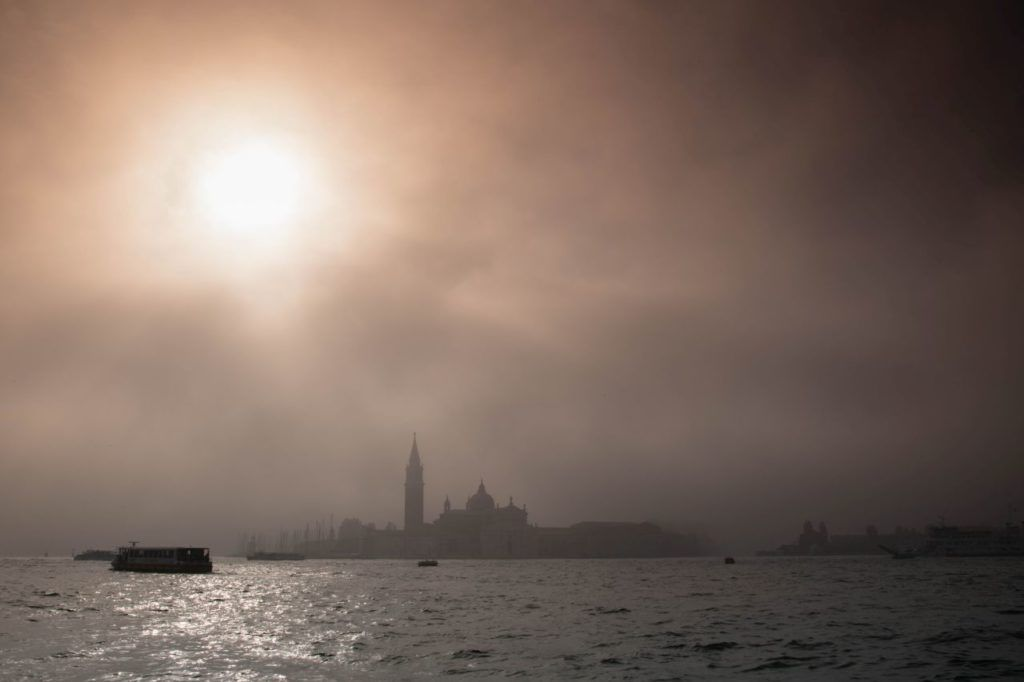 View of Venice from the water on a foggy day.