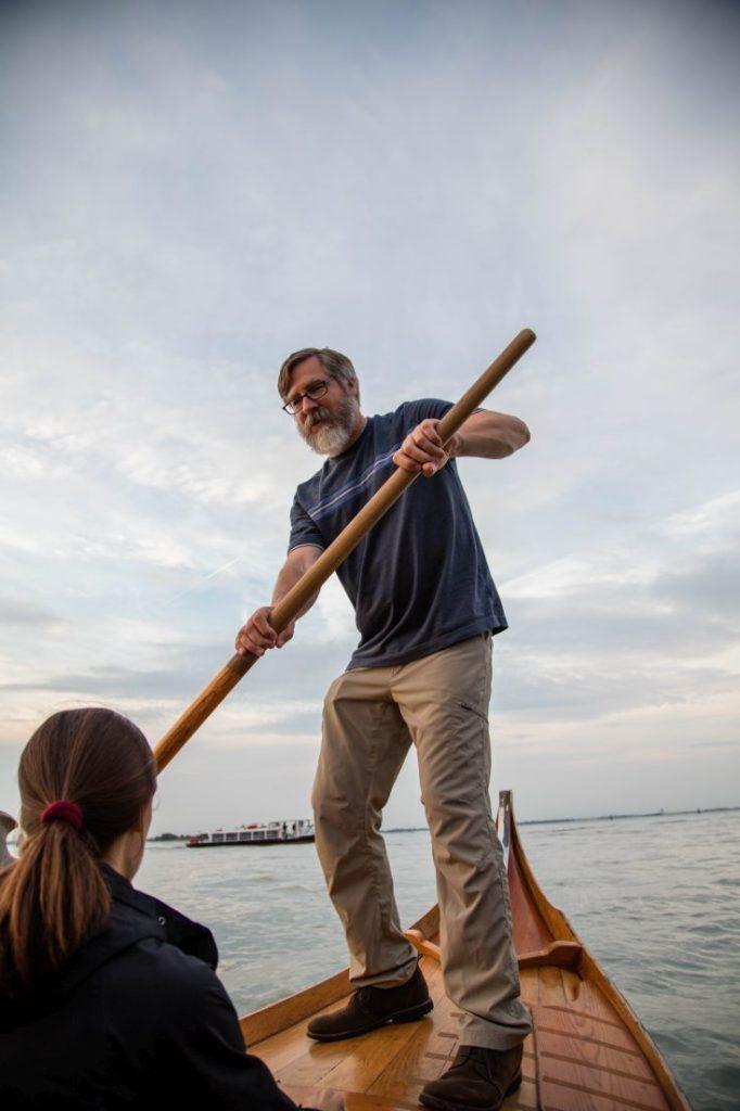 Jim takes the oar on the batellina.