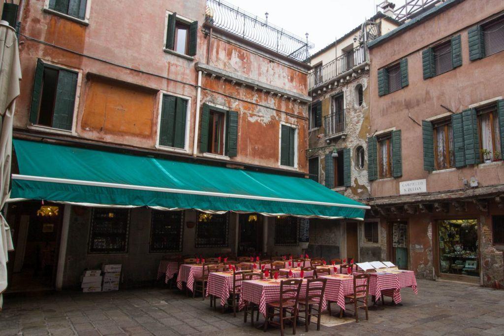 Quiet corner of Venice with outdoor restaurant.
