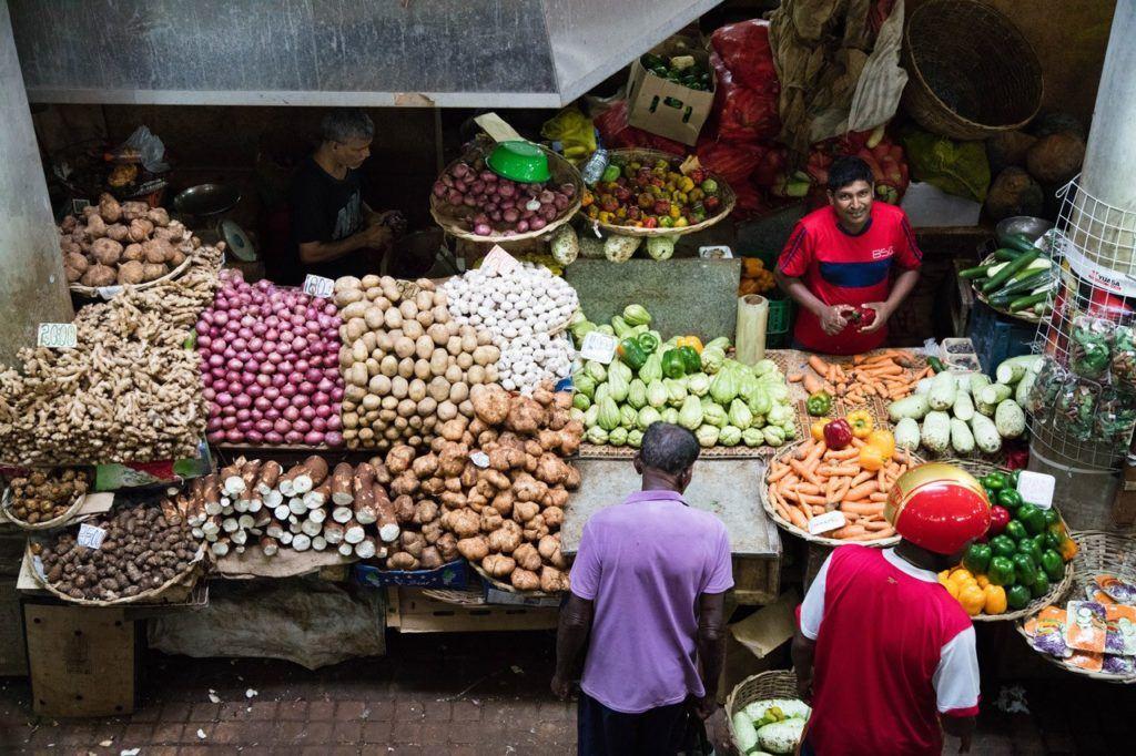 Produce Vendor in Port Louis Central Market.