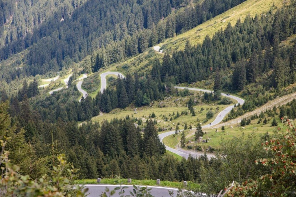 Driving in the best road through the Austrian Alps - the Grossglockner Highway.