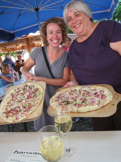 Two hungry fest goes are ready to dive into their local specialty of TarteFlambée!