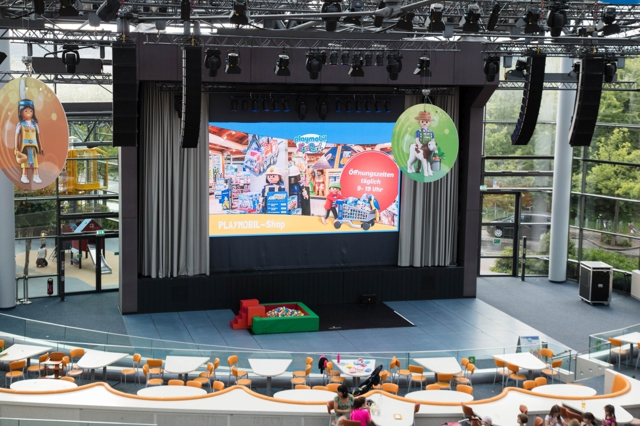 The big building hosts plenty of places to play as well as this Playmobil theater.