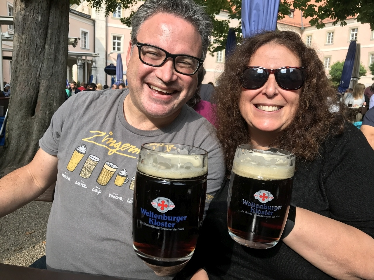 Prosit! Daryl and Mindi clink beer mugs