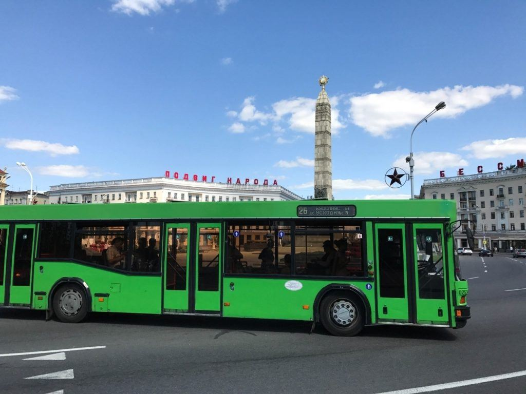 A green bus drives around Minsk