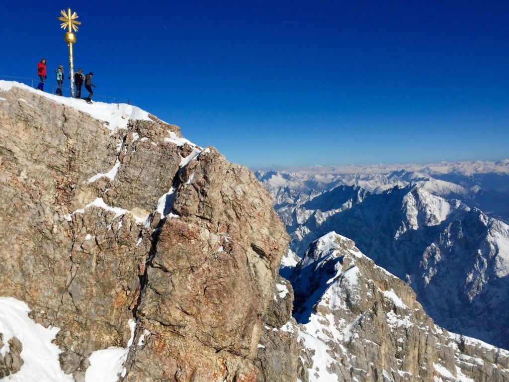 People on top of a mountain in southern Bavaria for a German winter.
