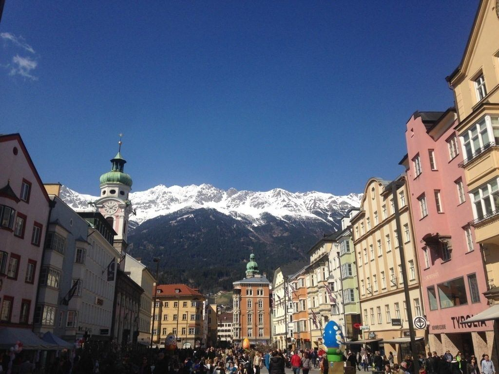 Innsbruck city scene with snow-capped mountains.