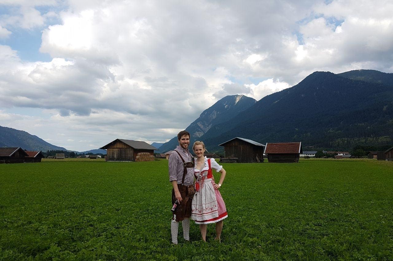 Tom and Jasmin in a dirndl and lederhosen.