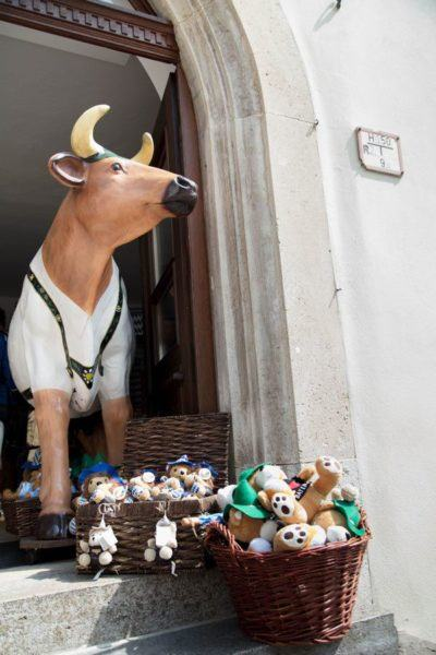 A huge cow and small stuffed animals invited people in to buy Rothenburg souvenirs.