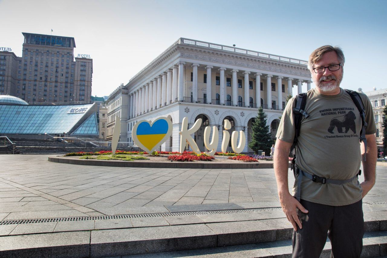 Jim standing in front of I love Kyiv sign.