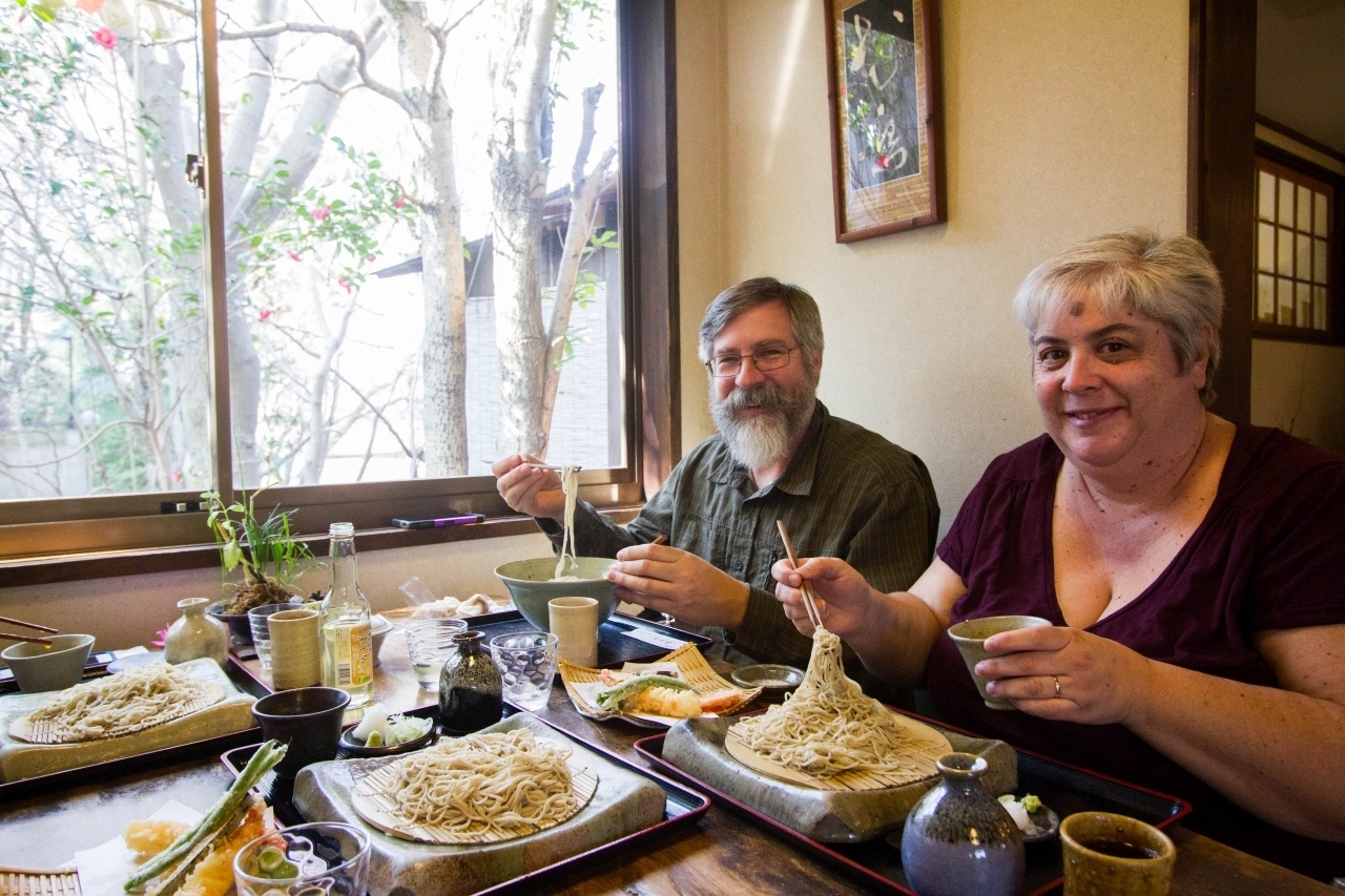 Jim and Corinne try foods all over the world. Here they are eating soba in Nara, Japan.
