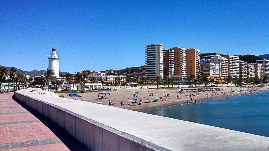 Malaga's beach with a few people on it.