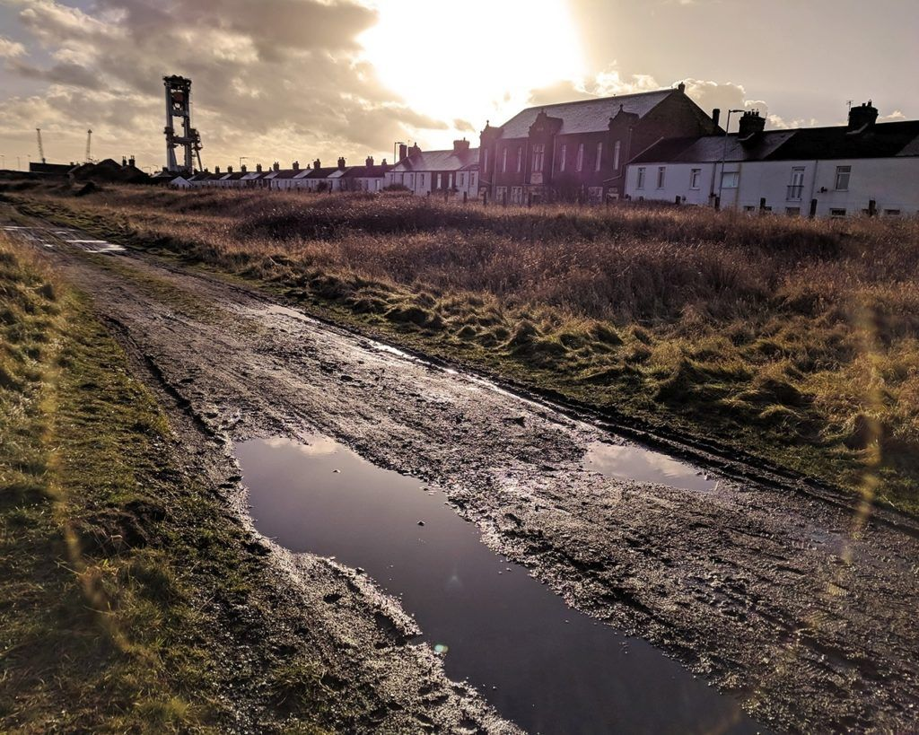 A muddy road at sunset in England.