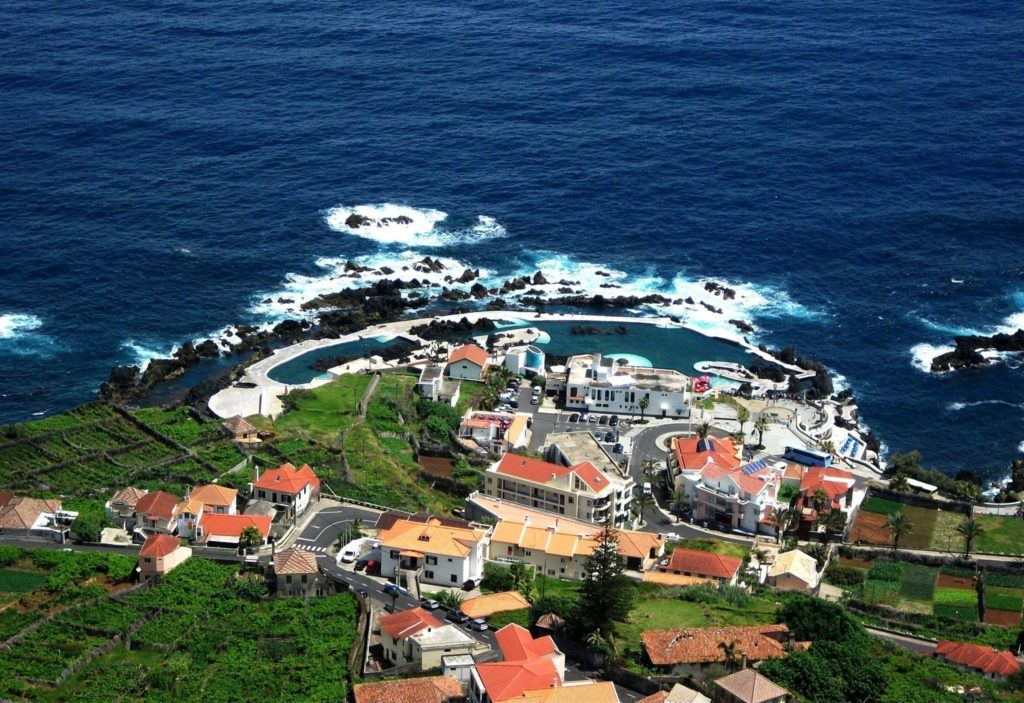 Blue waters and a small hamlet in Madeira, Portugal.