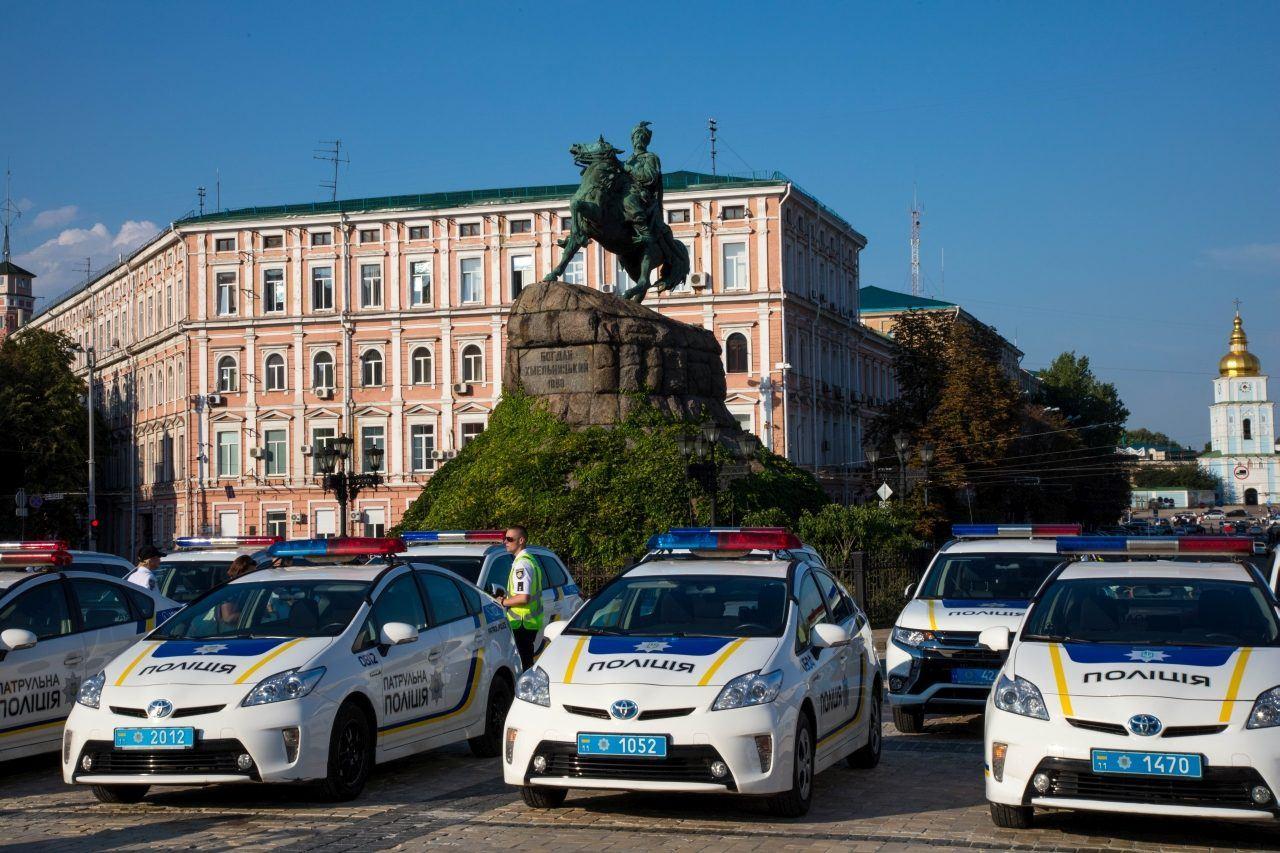 Police Cars in front of a statue in Kiev, Ukraine