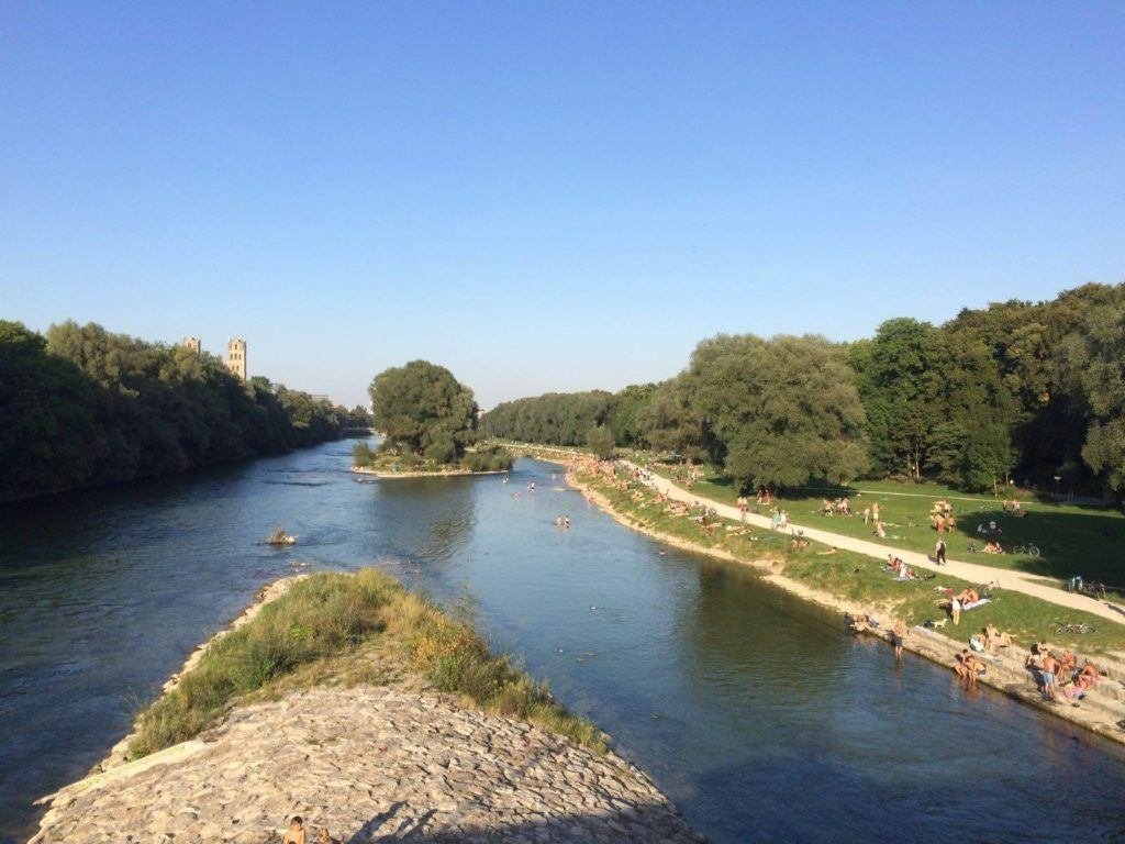 Summer bathers in the cool waters of the Isar river in Munich.